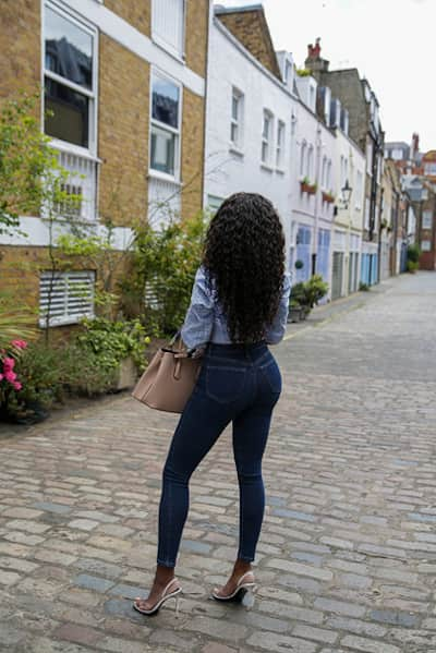 Black independent high class escort in London mews in tight jeans
